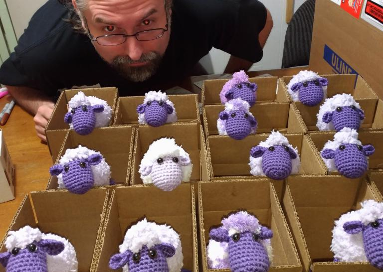 Trevor with many boxes of sheep